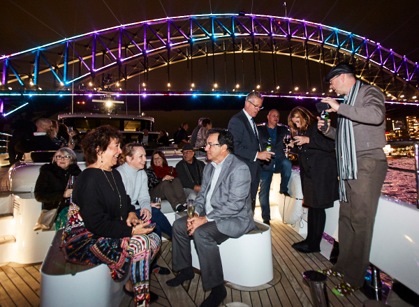 Guests socialising in front of Sydney Harbour Bridge
